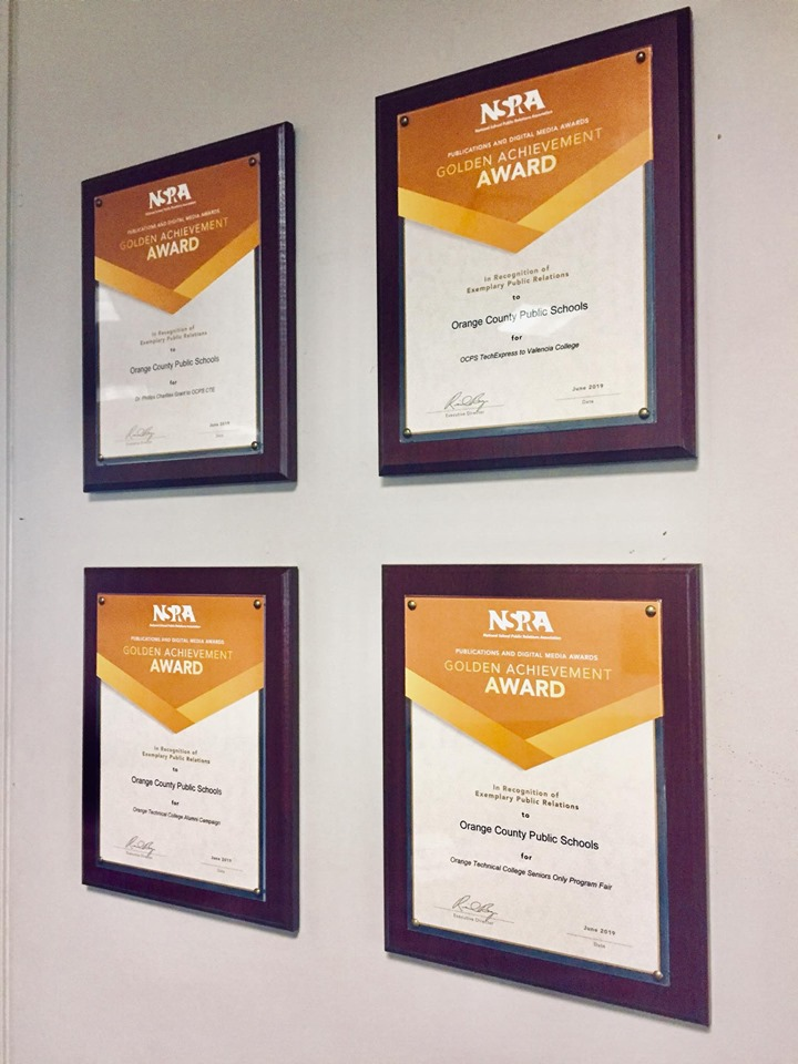 Image of the four National School Public Relations Association Golden Achievement Awards OTC was awarded.