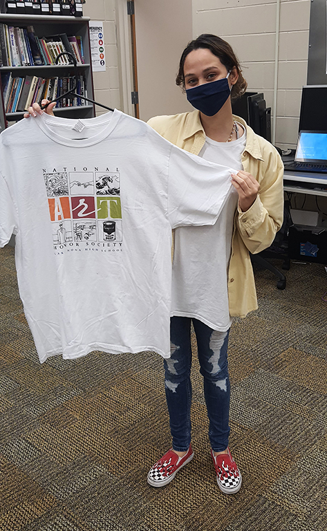Student holding a Lake Nona High School National Art Honor Society t-shirt