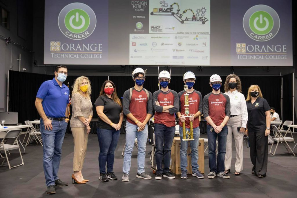 Associate Superintendent for CTE, Melanie Stefanowicz (pictured second from right), with Inaugural OTC Design Build Challenge student winners and Partners In Education from the Manufacturers Association of Central Florida.